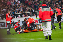 September 16, 2017 - Stuttgart, Germany - Stuttgarts Christian Gentner lies on the ground after a duel with Wolfsburgs keeper Casteels. He suffers a brain concussion and bone fractures  / Bundesliga match VfB Stuttgart vs VfL Wolfsburg, September 16, 2017. (Credit Image: © Bartek Langer/NurPhoto via ZUMA Press)