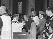 Episcopal Ordination Of Desmond Connell. (R74).1988..06.03.1988..03.06.1988..6th March 1988..Following the death of Archbishop Kevin McNamara in April '87, Pope John Paul II surprisingly nominated Desmond Connell for the position of Archbishop of Dublin. The ordination of Dr Connell took place at the Pro-Cathedral in Dublin...Picture shows An Taoiseach, Charles Haughey, accepting communion at the mass.