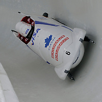 28 February 2007:    The Canada 1 bobsled driven by Pierre Lueders with sidepushers Ken Kotyk and David Bissett, and brakeman Justin Kripps drive through turn 20 in the 1st run at the 4-Man World Championships competition on February 27 at the Olympic Sports Complex in Lake Placid, NY.