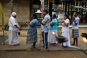 Pilgrims line up for blessings at the Temple of the Tooth, Sri Lanka's holiest Buddhist site.