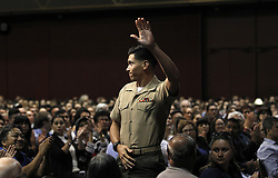 May 24, 2017 - San Diego, California, U.S.- Marine Sgt. LUIS ALVAREZ acknowledges the applause of other new citizens during the US Citizen swearing-in ceremony In San Diego. Hundreds of new citizens were sworn in during a ceremony at Golden Hall in San Diego Wednesday morning. Alvarez was born in Aguascalientes, Mexico, but raised in Yucca Valley, CA.  He has served in the Marine Corps since 2012 and feels he owes a debt of gratitude. 'I just want to give thanks to the country that has given so much to me,' he said.   (Credit Image: © John Gastaldo via ZUMA Wire)