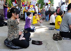 © licensed to London News Pictures. LONDON, UK.  27/06/11. Free Tibet protesters hold meditate opposite Downing Street. A protest was held outside Downing Street  today (27 June2011). The protest was aimed at the Chinese Premier, Wen Jiabao, who was visiting British Prime Minister David Cameron. Pro China and Free Tibet protesters where present. today (27 June2011). Mandatory Credit Stephen Simpson/LNP
