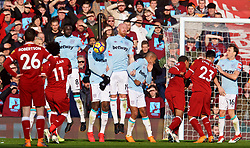 LIVERPOOL, ENGLAND - Saturday, February 24, 2018: Liverpool's Mohamed Salah takes a free-kick as West Ham United's James Collins blocks during the FA Premier League match between Liverpool FC and West Ham United FC at Anfield. (Pic by David Rawcliffe/Propaganda)