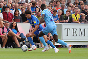 AFC Wimbledon defender Will Nightingale (5) battles for possession with Coventry City Amadou  Bakayoko (21) during the EFL Sky Bet League 1 match between AFC Wimbledon and Coventry City at the Cherry Red Records Stadium, Kingston, England on 11 August 2018.