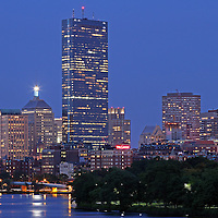 Boston skyline photography showing historic landmarks such as the Lenox Hotel, Brownstone building and John Hancock Tower cityscape on a beautiful summer night.<br />