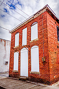 An abandoned boarded up building stands on E Marion St in downtown Kershaw, South Carolina