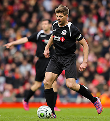 Steven Gerrard in action  - Photo mandatory by-line: Matt McNulty/JMP - Mobile: 07966 386802 - 29/03/2015 - SPORT - Football - Liverpool - Anfield Stadium - Gerrard's Squad v Carragher's Squad - Liverpool FC All stars Game