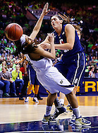 SOUTH BEND, IN - MARCH 04: Skylar Diggins #4 of the Notre Dame Fighting Irish takes a charge from Stefanie Dolson #31 of the Connecticut Huskies at Purcel Pavilion on March 4, 2013 in South Bend, Indiana. (Photo by Michael Hickey/Getty Images) *** Local Caption *** Skylar Diggins; Stefanie Dolson