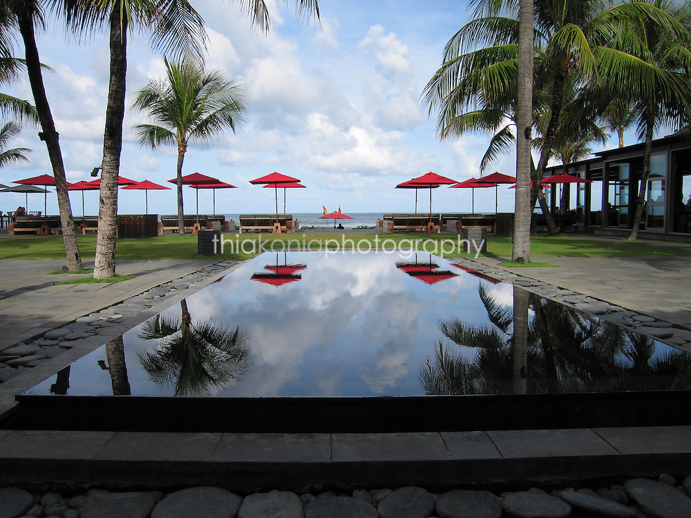 Looking out to the red umbrellas from the refledtion pool at Ku De Ta Restaurant in Bali.
