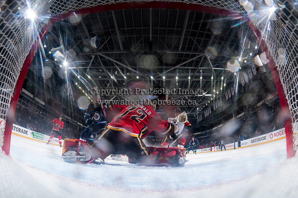 PENTICTON, CANADA - SEPTEMBER 11: Mason McDonald #72 of the Calgary Flames makes a glove save against the Winnipeg Jets on September 11, 2017 at the South Okanagan Event Centre in Penticton, British Columbia, Canada.  (Photo by Marissa Baecker/Shoot the Breeze)  *** Local Caption ***
