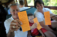 LANSDALE, PA - AUGUST 24: L-R Tom Borneman, Jackson Headly, 4, and Kathy Boreman of Lansdale, Pennsylvania show off their tickets aboard the New Hope and Ivyland Railroad during Founders Day August 24, 2013 in Lansdale, Pennsylvania. The New Hope and Ivyland Railroad made special trips as part of Founders Day from Lansdale to Souderton. (Photo by William Thomas Cain/Cain Images)