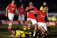 Photo: Olly Greenwood.<br />Charlton Athletic v Aston Villa. The Barclays Premiership. 25/02/2006. <br />Aston Villa's Gavin McCann slides into the back of Charlton's Radostin Kishishev and Luke Young.