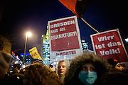 Frankfurt am Main | 02 Feb 2015<br /> <br /> Am Montag (02.02.2015) demonstrierten in Frankfurt an der Hauptwache etwa 60 PEGIDA-Anh&auml;nger mit teils extrem rassistischen Reden und Parolen z.B: gegen &quot;Islamisierung&quot;, an den Aktionen gegen die Rechtsextremisten nahmen mehrere tausend Menschen teil.<br /> Hier: Gegendemonstranten mit einem kleinen Transparent mit der Aufschrift &quot;Dresden raus aus Frankfurt&quot;.<br /> <br /> &copy;peter-juelich.com<br /> <br /> [No Model Release | No Property Release]