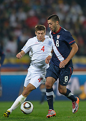 12.06.2010, Royal Bafokeng Stadium, Rustenburg, RSA, FIFA WM 2010, England (ENG) vs USA (USA), im Bild Clint Dempsey of USA in action with Steven Gerrard of England, EXPA Pictures © 2010, PhotoCredit: EXPA/ IPS/ Mark Atkins / SPORTIDA PHOTO AGENCY