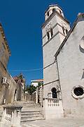 Bright church with church tower in Cavtat. Croatia. Eastern Europe.