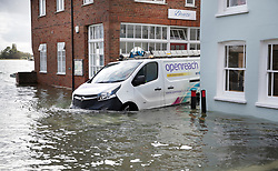© Licensed to London News Pictures. 01/10/2019. Bosham, UK. A BT van wades through flood waters as high tide floods roads in the village of Bosham in West Sussex. Parts of the South are being affected by the aftermath of Hurricane Lorenzo with numerous flood warnings in place. Photo credit: Peter Macdiarmid/LNP