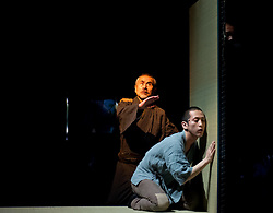 "© Copyright licensed to London News Pictures. 05/11/2010. Old Sasuke (Yoshi Oida) and Young Sasuke (Songha Cho) listen at the wall. Complicite present ""Shun-Kin"" at the Barbican, London. Directed by Simon McBurney, based on the writings of Jun'ichiro Tanizaki."