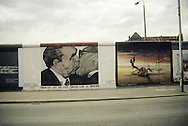 "In this photograph created in May 1991, a painting titled, ""The Fraternal Kiss,"" in the East Gallery on the Berlin Wall depicts  the former leader of the Soviet Union, L. Brezhnev, in a lip lock with the former head of East Germany, E. Honecker."