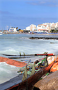 "Tenerife / Los Cristianos June 7, 2006 - A fishing boat called ""Cayucos"" , is found on the beach  - A fishing boat called ""Cayucos"" by the inhabitants of the island, with 85 would-be immigrants from West Africa intercepted by Spanish police of the coast of Tenerife in the Canary Islands are seen in an open wooden fishing vessel as they approach the port of Los Cristianos. They arrived on June, carrying 85 would-be immigrants, in the archipelago which has received more than 7,000 Africans so far this year, more than half to the tourist resort island of Tenerife. At least 1,000 more are believed to have died trying to make the sea crossing, mostly in small fishing boats"