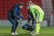 Concern as Sarah Bouhaddi (France) receives treatment during the International Friendly match between England Women and France Women at the Keepmoat Stadium, Doncaster, England on 21 October 2016. Photo by Mark P Doherty.