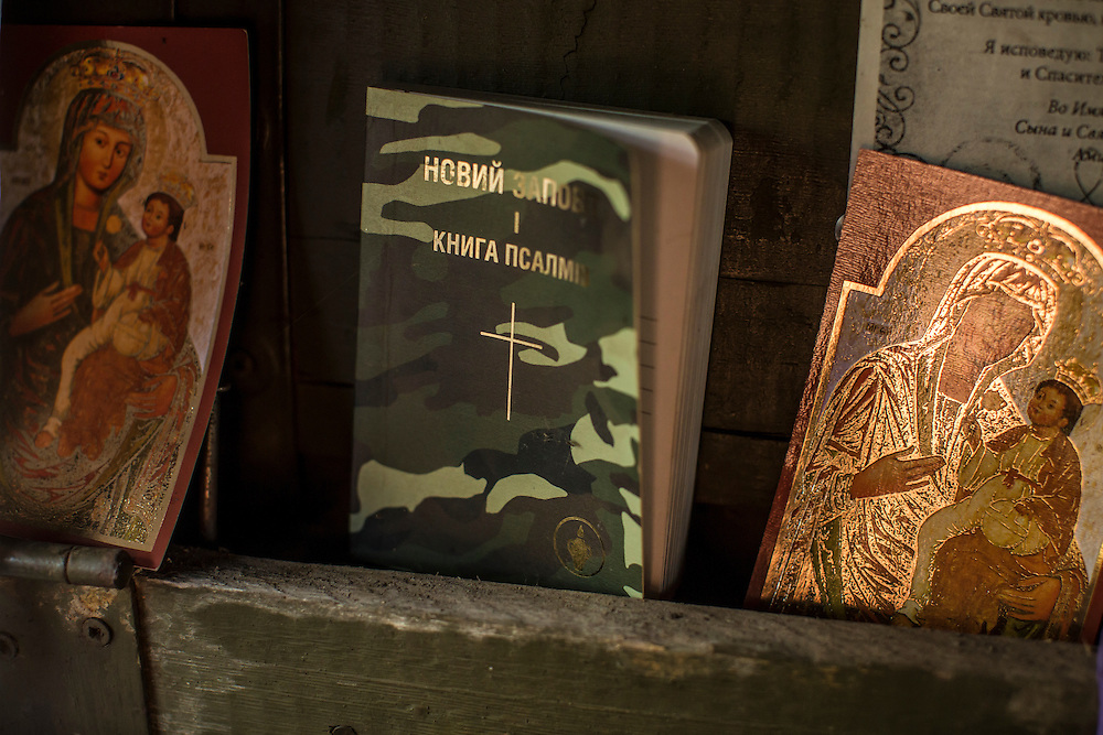 AVDIIVKA, UKRAINE - JULY 9, 2016: Religious icons and a bible are stashed in a front-line bunker in Avdiivka, Ukraine. The town is now one of the most active areas of fighting along the line of control between the Ukrainian government and Russian-backed rebels. CREDIT: Brendan Hoffman for The New York Times