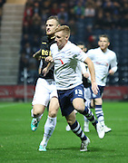 Eoin Doyle and David Wheater battle during the Sky Bet Championship match between Preston North End and Bolton Wanderers at Deepdale, Preston, England on 31 October 2015. Photo by Pete Burns.