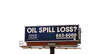 """A giant electronic billboard advertisement placed by a law firm is on display in Gulfport, Mississippi May 9, 2010.  Lawyers offering to represent people impacted by the BP oil spill are running newspaper, radio ads and billboard ads in the area. BP Chief Executive Tony Hayward said a $75 million legal cap on the liabilities for economic damages under federal law, which some U.S. lawmakers now want to raise, would not be a limit and renewed promises to meet all """"legitimate"""" claims.  REUTERS/Rick Wilking (UNITED STATES)"""