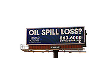 "A giant electronic billboard advertisement placed by a law firm is on display in Gulfport, Mississippi May 9, 2010.  Lawyers offering to represent people impacted by the BP oil spill are running newspaper, radio ads and billboard ads in the area. BP Chief Executive Tony Hayward said a $75 million legal cap on the liabilities for economic damages under federal law, which some U.S. lawmakers now want to raise, would not be a limit and renewed promises to meet all ""legitimate"" claims.  REUTERS/Rick Wilking (UNITED STATES)"