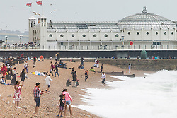 © Licensed to London News Pictures. 25/06/2017. Brighton, UK. Few brave people make the most of their time on the beach in Brighton and Hove as the seaside resort is being hit by grey clouds and powerful waves. Photo credit: Hugo Michiels/LNP