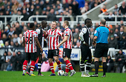 NEWCASTLE, ENGLAND - Sunday, March 4, 2012: Newcastle United's Papiss Cisse clashes with Sunderland's Phil Bardsley during the Premiership match at St. James' Park. (Pic by David Rawcliffe/Propaganda)