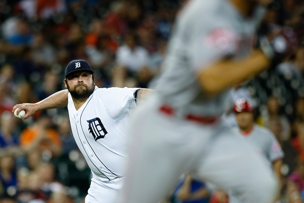 Jun 16, 2015; Detroit, MI, USA; Detroit Tigers relief pitcher Joba Chamberlain (44) makes a throw to first to get Cincinnati Reds shortstop Kris Negron (17) out in the ninth inning at Comerica Park. Cincinnati won 5-2. Mandatory Credit: Rick Osentoski-USA TODAY Sports