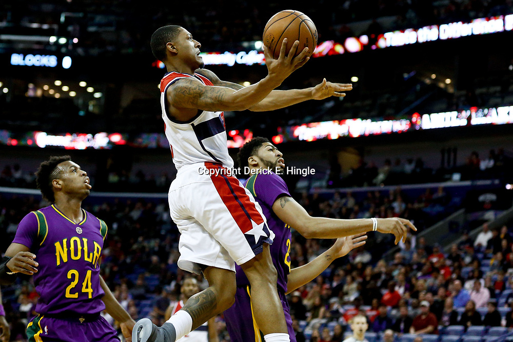 Jan 29, 2017; New Orleans, LA, USA; Washington Wizards guard Bradley Beal (3) shoots over New Orleans Pelicans forward Anthony Davis (23) during the first quarter of a game at the Smoothie King Center. Mandatory Credit: Derick E. Hingle-USA TODAY Sports