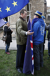 © Licensed to London News Pictures. 05/02/2018. London, UK. Conservative MP David Davies has a confrontation with EU flag waving supporters outside Parliament. Earlier Brexit Secretary David Davis met with European Commission's Chief Negotiator Michel Barnier in Downing Street for talks. Photo credit: Peter Macdiarmid/LNP