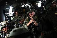 Members of the Jungla, a unit of the Colombian anti-narcotics police, ride in a Blackhawk helicopter during a mission to destroy coca labs in the Colombian state of Bolivar, on July 3, 2007. (Photo/Scott Dalton)