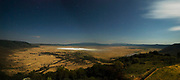 Overlooking the fantastic Ngorongoro Crater at night when the stars are visible over the crater.