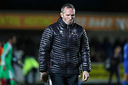 Lincoln City Michael Appleton walking off the pitch not smiling during the EFL Sky Bet League 1 match between AFC Wimbledon and Lincoln City at the Cherry Red Records Stadium, Kingston, England on 2 November 2019.