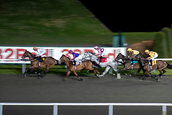 Horses and jockeys race in the 32Red On The App Store Novice stakes at Kempton Park Racecourse, Esher.