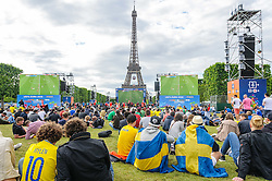 Fans look towards the Eiffel Tower while watching Austria v Hungary on the big screens at the Paris fanzone. Images from the UEFA EURO 2016, 14 June 2016 in Fan Zone. (c) Paul Roberts | Edinburgh Elite media. All Rights Reserved