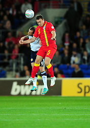 Scotland's Steven Fletcher (Sunderland)    battles for the high ball with Wales Darcy Blake (Crystal Palace) - Photo mandatory by-line: Joe Meredith/JMP  - Tel: Mobile:07966 386802 12/10/2012 - Wales v Scotland - SPORT - FOOTBALL - World Cup Qualifier -  Cardiff   - Cardiff City Stadium -