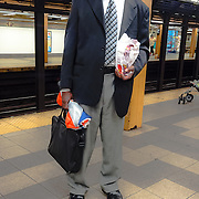 Commute 34thStStation: a man waits on the platform, there was a chance of rain this day, by joshua Solson