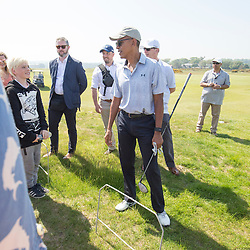 Former US president Barack Obama playing golf at St Andrews