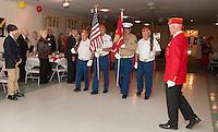 Commandant Robert Patenaude presents colors during the 239th birthday celebration of the Marine Corp Saturday evening at Pheasant Ridge.  (Karen Bobotas/for the Laconia Daily Sun)