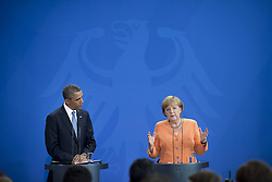 59860284    <br /> Barack Obama, president of the USA, and German Chancellor Angela Merkel (right) during a press call at a state visit of the Chancellery in Berlin, Germany. Barack Obama will walk in John F. Kennedy's footsteps this week on his first visit to Berlin as US president, but encounter a more powerful and sceptical Germany in talks on trade and secret surveillance practices. International Politics, Berlin, Germany on Wednesday 19 June, 2013. UK ONLY