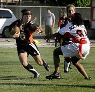 Senior Kelly Blumenschein (16) runs during the 3rd Annual Powderpuff Challenge, the junior girls (class of 2008) against the senior girls (class of 2007.)