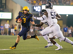 Sep 5, 2015; Morgantown, WV, USA; West Virginia Mountaineers quarterback Skyler Howard scrambles out of the pocket during the third quarter against the Georgia Southern Eagles at Milan Puskar Stadium. Mandatory Credit: Ben Queen-USA TODAY Sports
