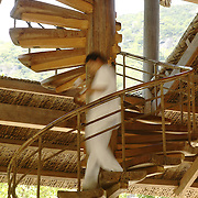 A waiter descends a spiral staircase at the Evason Hideaway in Nha Trang, Vietnam.