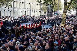 © Licensed to London News Pictures. 13/11/2016. London, UK.  Whitehall filled with servicemen and members of the public for a Remembrance Day Ceremony at the Cenotaph war memorial in London, United Kingdom, on November 13, 2016 . Thousands of people honour the war dead by gathering at the iconic memorial to lay wreaths and observe two minutes silence. Photo credit: Ben Cawthra/LNP