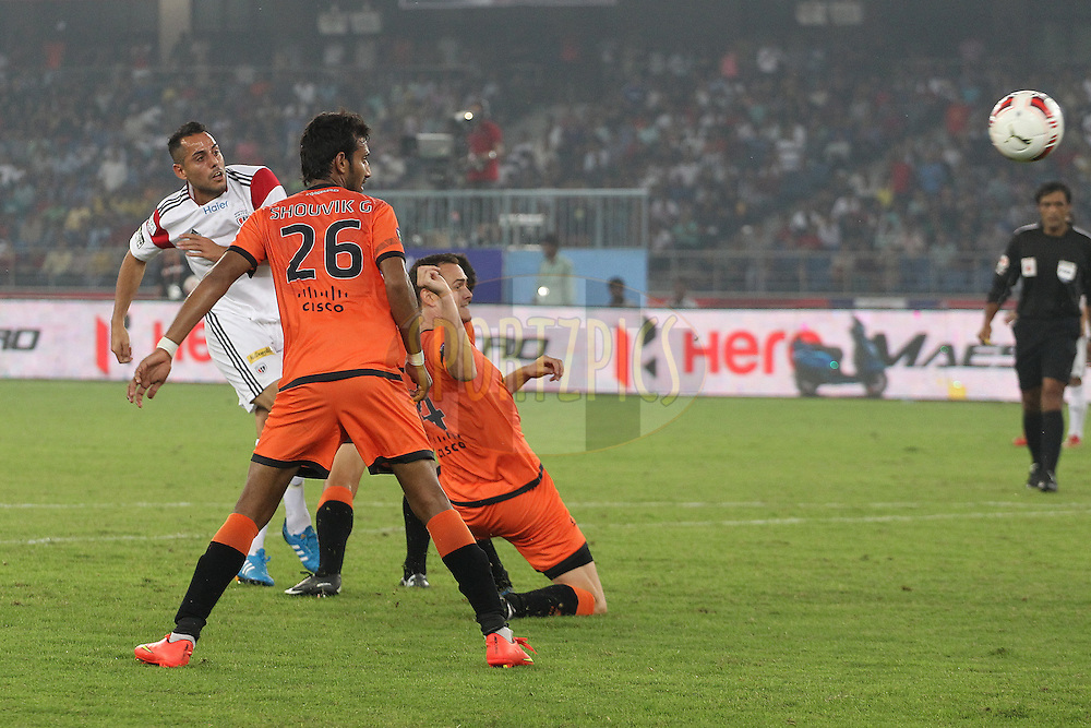 Leo Bertos of NorthEast United FC shoots for goal during match 16 of the Hero Indian Super League between The Delhi Dynamos FC and NorthEast United FC held at the Jawaharlal Nehru Stadium, Delhi, India on the 29th October 2014.<br /> <br /> Photo by:  Ron Gaunt/ ISL/ SPORTZPICS