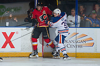PENTICTON, CANADA - SEPTEMBER 8: Davis Koch #39 of Edmonton Oilers checks Kayle Doetzel #43 of Calgary Flames into the boards during first period on September 8, 2017 at the South Okanagan Event Centre in Penticton, British Columbia, Canada.  (Photo by Marissa Baecker/Shoot the Breeze)  *** Local Caption ***