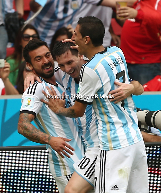 Fifa Soccer World Cup - Brazil 2014 - <br /> NIGERIA  (NGA) Vs. ARGENTINA (ARG) - Group F - Estadio Beira-RioPorto Alegre - Brazil (BRA) - June 25, 2014 <br /> Here Argentine player Lionel Messi celebrating his second goal with the player Ezequiel Lavezzi and Angel Di Maria. Scoring the match 2-1<br /> &copy; PikoPress